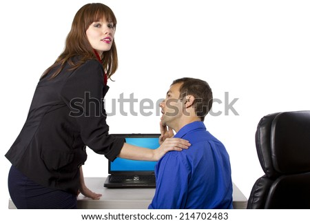 female coworker is flirting to get favors at work - stock photo