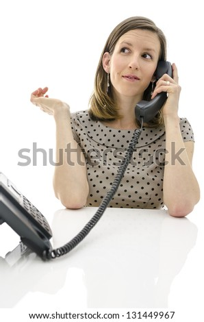 Female customer support operator talking on a telephone. - stock photo