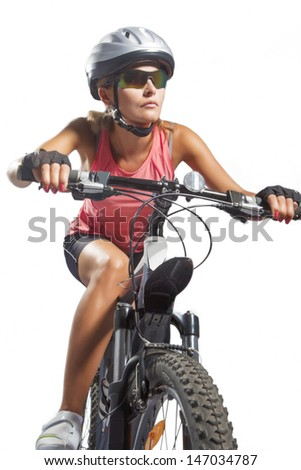 female cycling athlete riding mountain bike and equipped with professional bike gear isolated over white. vertical shot - stock photo