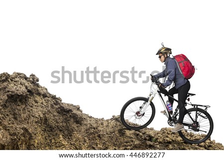 Female cycling athlete riding mountain bike, isolated on white background - stock photo