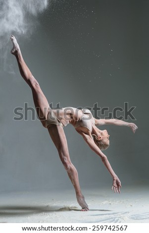 female dancer posing in studio - stock photo