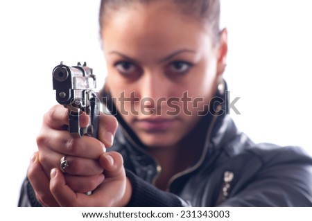 Female detective shooting with gun isolated on white background. Focus is on the gun. - stock photo