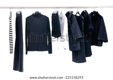 female different clothing on wooden hangers at the show  - stock photo