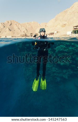 female diver ready to dive - stock photo