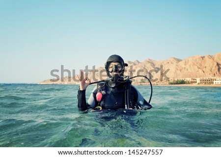 female diver shows a sign okay - stock photo