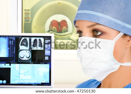 female doctor and computer tomographic scanner in hospital - stock photo