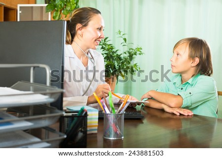 Female doctor and patient teenager discussing health issues - stock photo