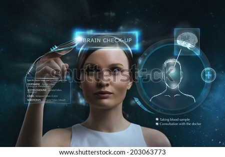 Female doctor doing checkup of human brain using futuristic computer technology - stock photo