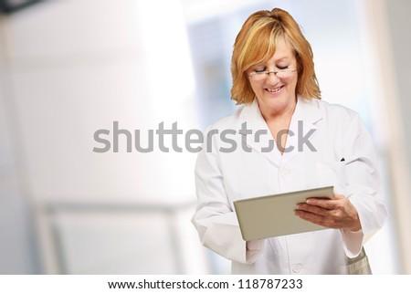 female doctor holding digital tablet, indoor - stock photo