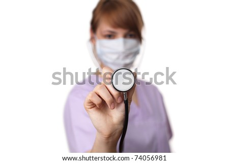Female doctor holding stethoscope pointed toward camera 5. selective focus - stock photo