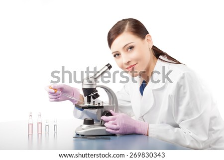 Female doctor or scientific researcher using microscope in a laboratory. - stock photo
