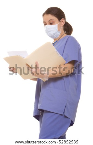 Female doctor reading a patient's chart - stock photo