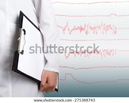 Female doctor's hand holding clipboard on blurred medical blue background whit ecg line. Concept of Healthcare And Medicine. Copy space - stock photo