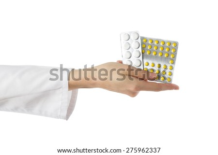 Female doctor's hand holding medical pills isolated on white background. First aid. - stock photo