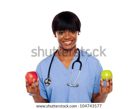 Female doctor showing fresh red and green apples on white background - stock photo