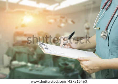 female doctor,surgeon,nurse,pharmacy with stethoscope on hospital holding clipboard,writing a prescription,Medical Exam,Healthcare and medical concept,test results,patient registration,selective focus - stock photo