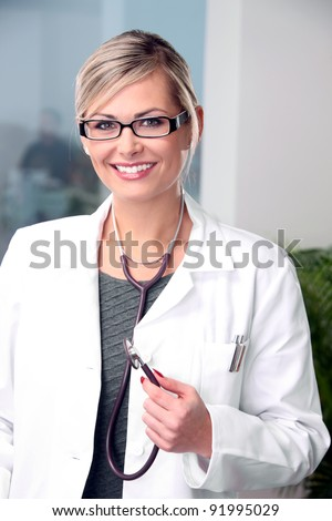 Female doctor with stethoscope - stock photo