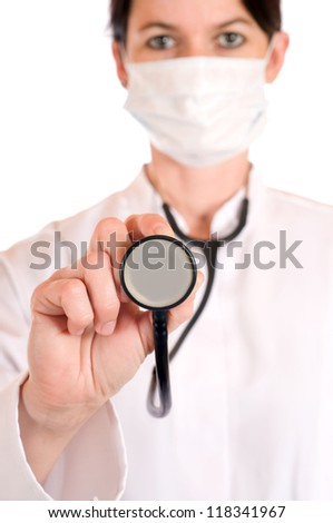 Female doctor with stethoscope in selective focus - stock photo