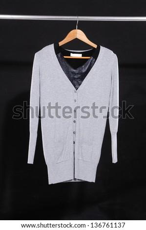 female dress isolated on hanging-black background - stock photo