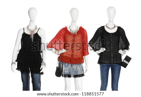 female dress with d bag on three mannequin - stock photo