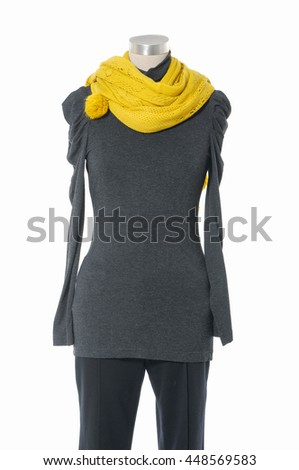 female dress with red scarf and trousers on n mannequin    - stock photo