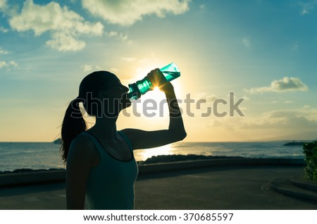 Female drinking a refreshing drink of water.  - stock photo