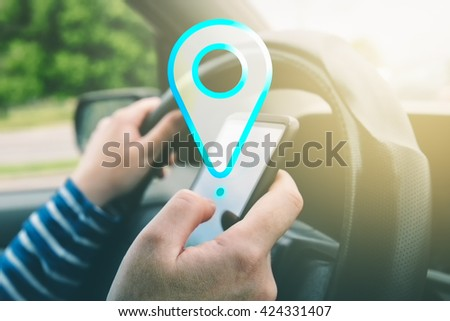 Female driving car and using gps navigation app on smartphone to find destination, using mobile phone in traffic. - stock photo