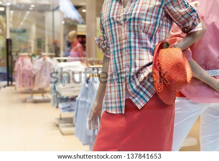 Female dummy inside a casual clothing store - stock photo