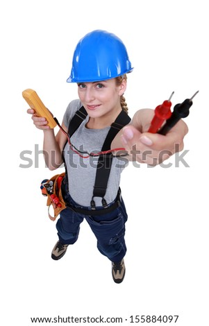 female electrician holding a measurement tool - stock photo