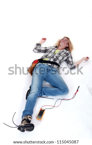 Female electrician suffering an electric shock - stock photo