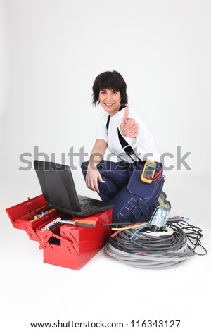 female electrician, thumbs up - stock photo
