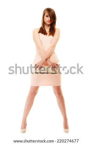 Female elegance. Full length of attractive girl young woman in elegant light pink dress and with handbag isolated on white. - stock photo
