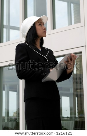 Female Engineer Checking Work Order - stock photo