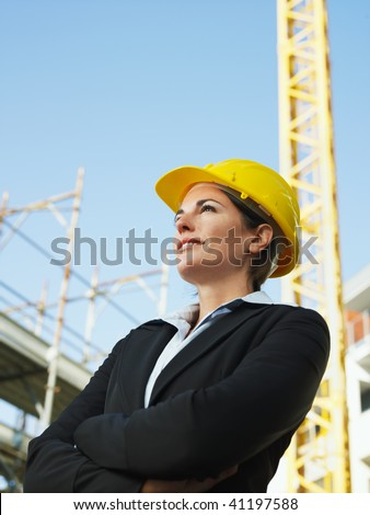 female engineer with arms folded looking away. Copy space - stock photo