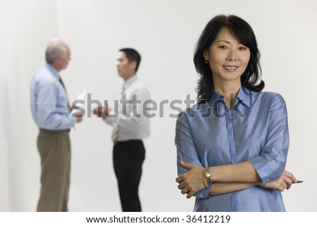 Female executive and her team - stock photo