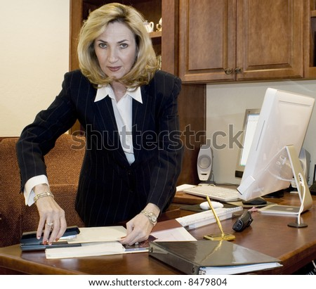 Female executive at her desk - stock photo