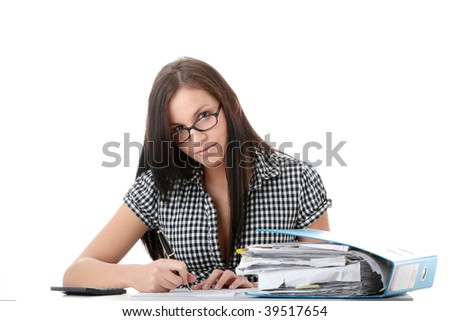 Female executive filling out tax forms while sitting at her desk. Isolated - stock photo