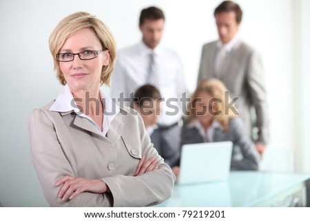 Female executive wearing glasses - stock photo