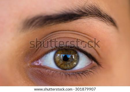 Female eye photographed with macro lens - stock photo