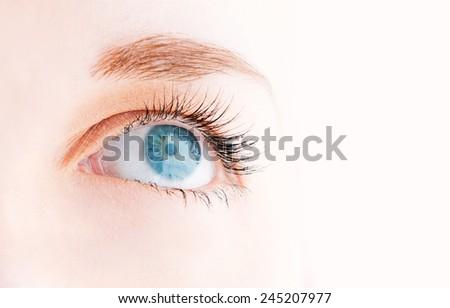 Female eye with long eyelashes looking up close up  - stock photo