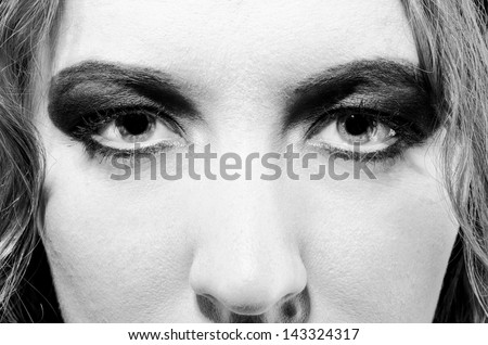 female face close-up with make up in glam rock style - stock photo