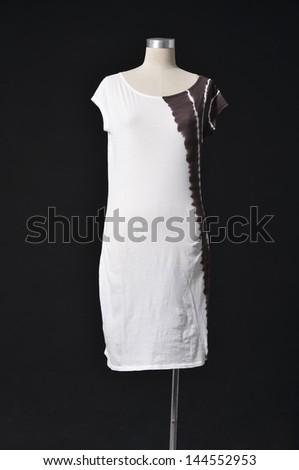 female fashion dress on mannequin-black background - stock photo