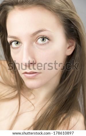 female fashion model blond hair,head shot portrait, long hair, white skin ,light green eyes, naked shoulders - stock photo