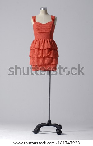female fashion red dress on female mannequin-gray background  - stock photo