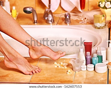 Female  feet in bubble bath. Skincare. - stock photo