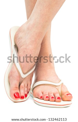 female feet in sandals on a white background - stock photo