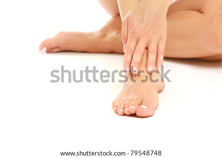 Female feet isolated on white - stock photo