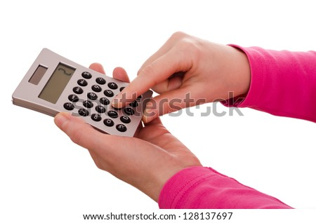 Female finger is typing on a pocket calculator - stock photo