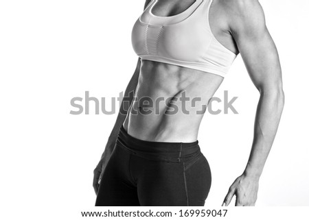 Female Fitness Body Builder with Intense Abs - stock photo