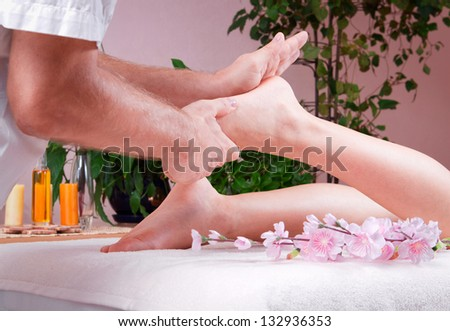 female foot massage - stock photo